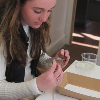 Grace inspecting a knife