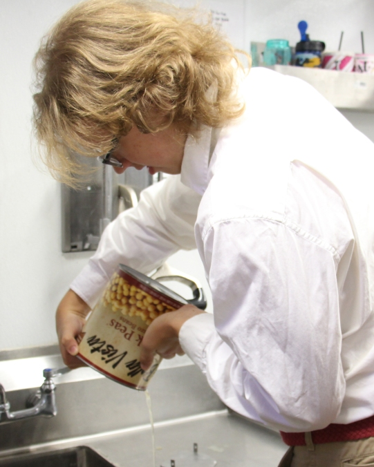 Arthur draining chickpeas