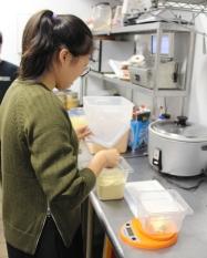 Katherine measuring ingredients for hummus