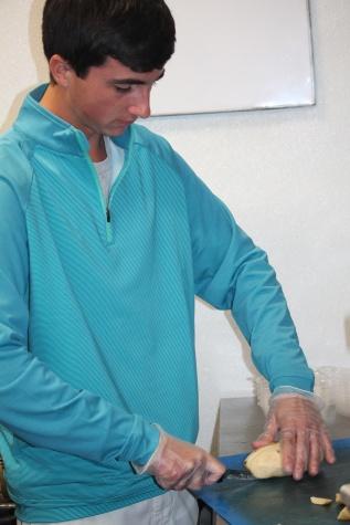Alex cutting potatoes
