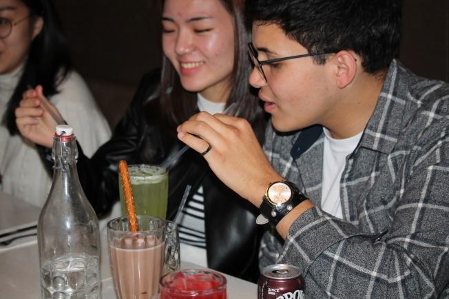 Scarlett and Michael enjoying their cucumber drink