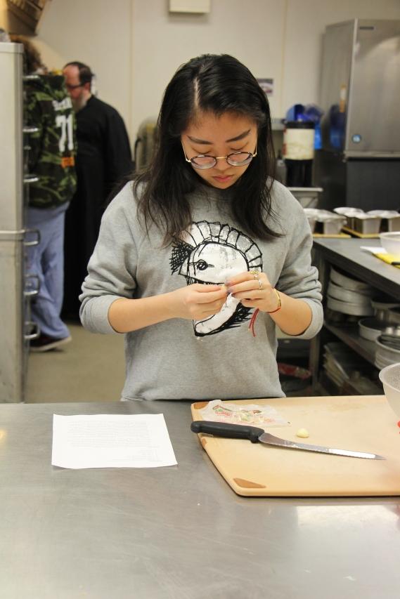 Katherine peeling garlic